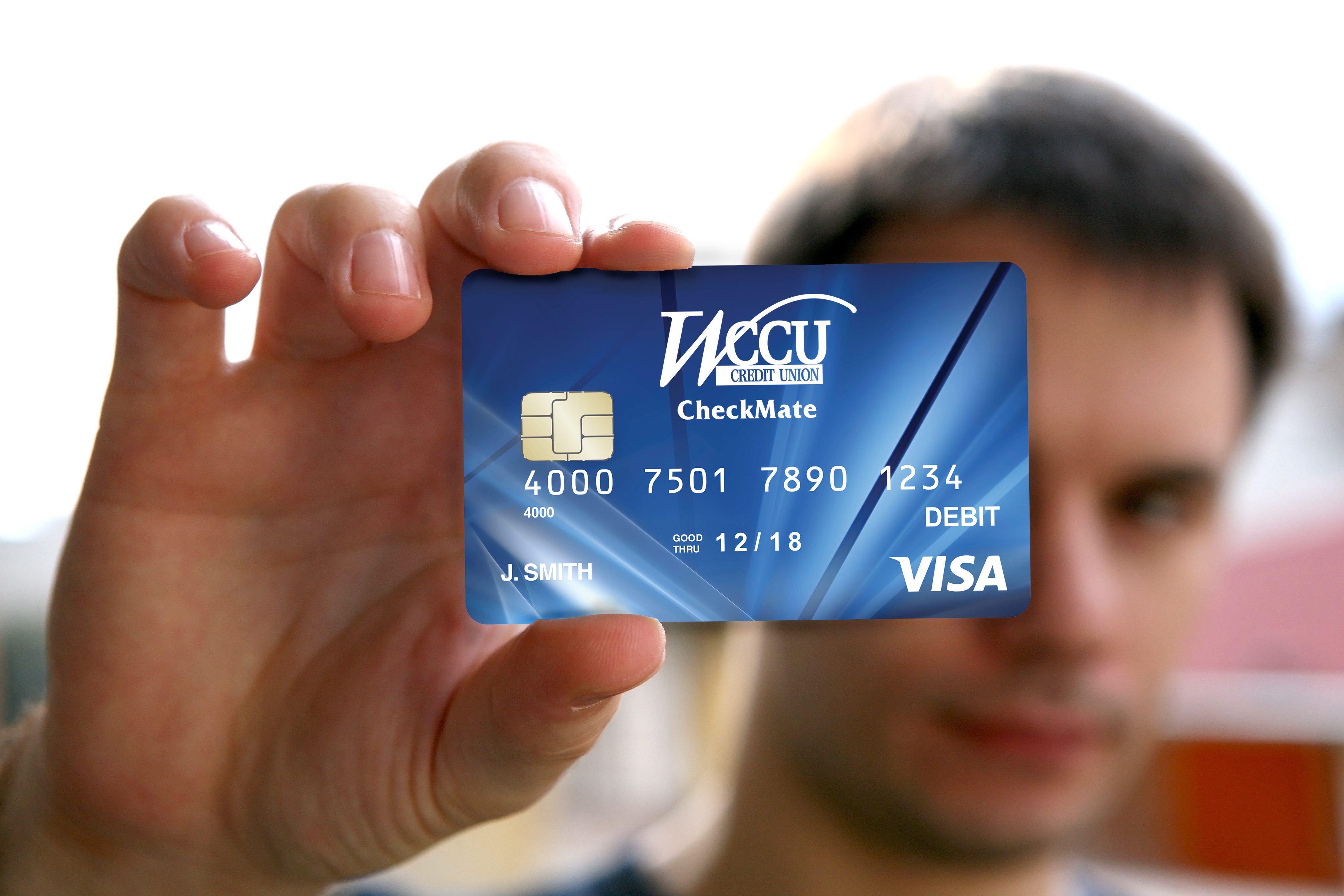 man holding a blank id card with chip wccu credit union