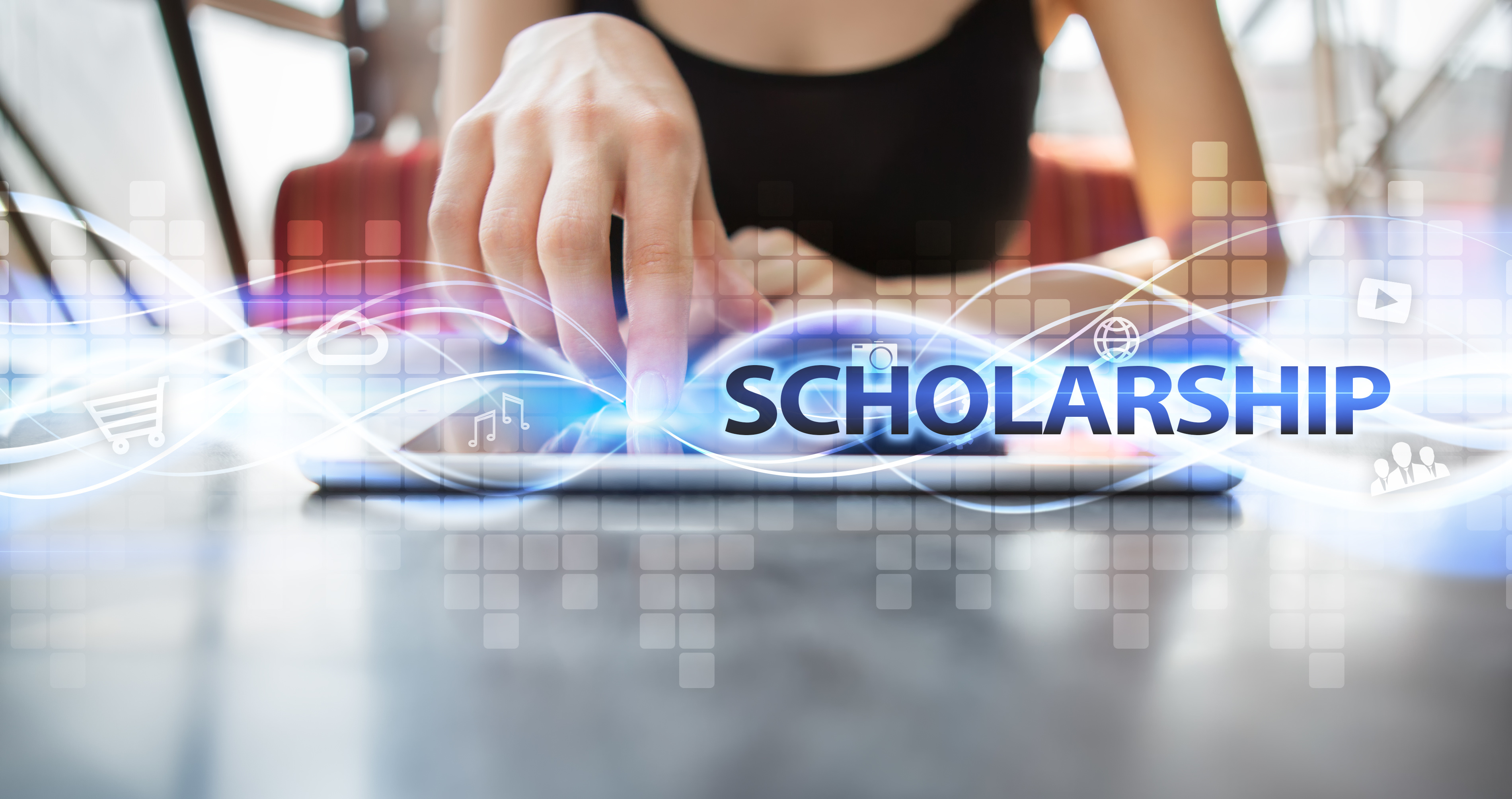Woman using tablet pc and selecting scholarship.
